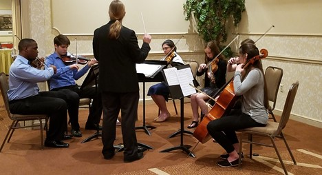 Students performing in an orchestra ensemble