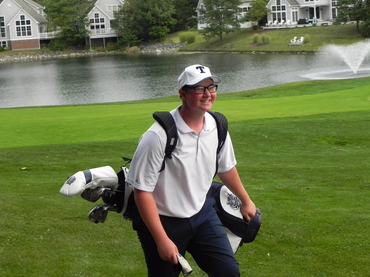 Golfer walking to shot