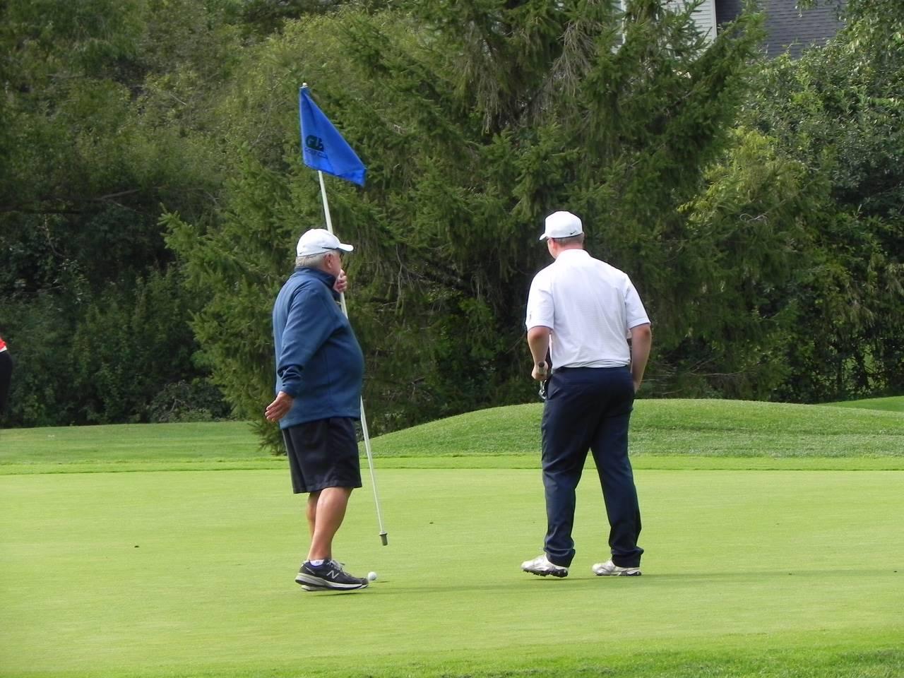 Golfer with coach