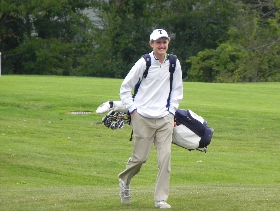 Golfer walking to green