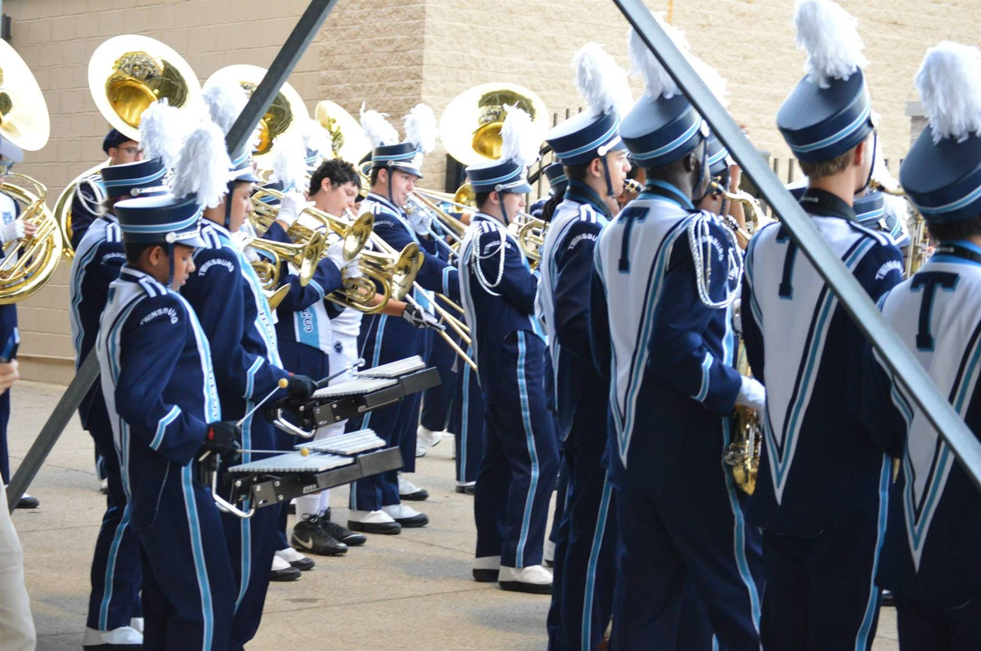 Marching Band Students warming up before a half time performance