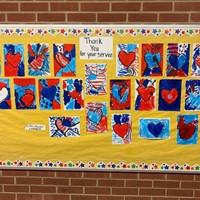 bulletin board with art work thanking veterans