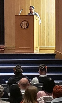 student standing at a podium