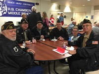 veterans and a student sitting around a table