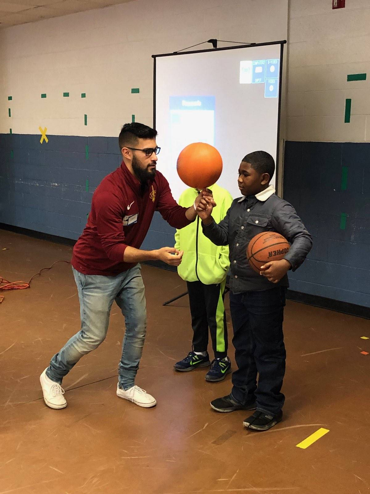 students learning how to spin a basketball
