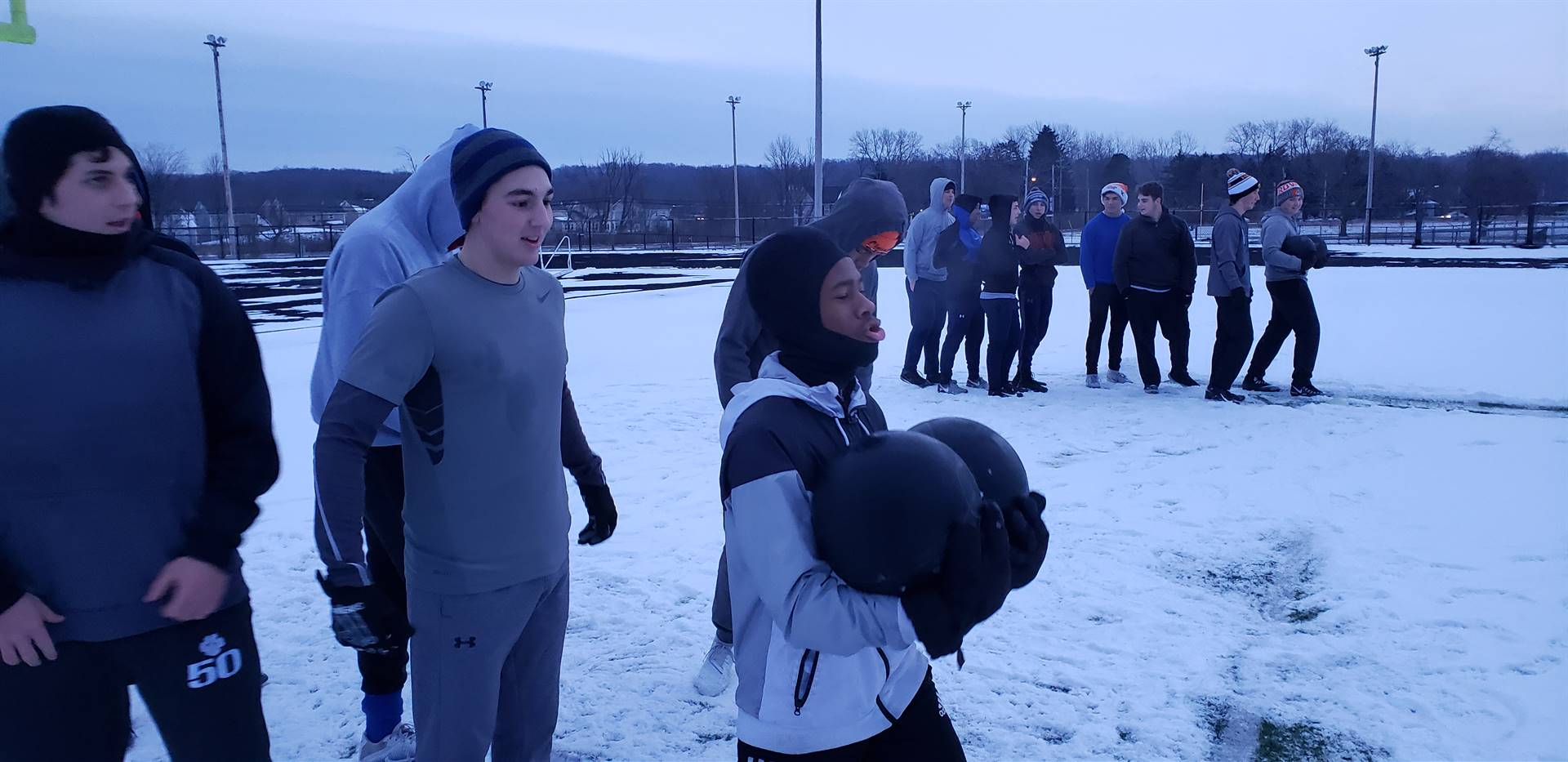 Blue Dawn 1:  Players competing in the medicine ball relay.