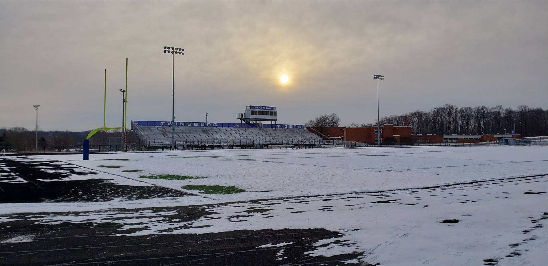 Blue Dawn 1:  The sun rising over the visiting bleachers at Tiger Stadium.