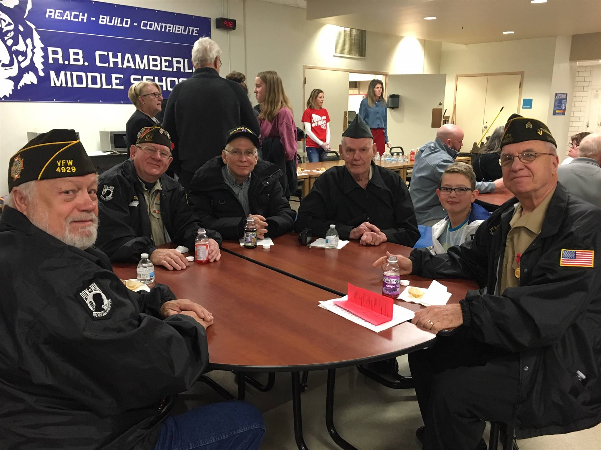 veterans and student sitting at a table