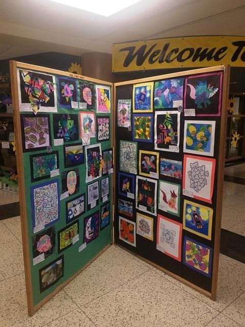student artwork on display board