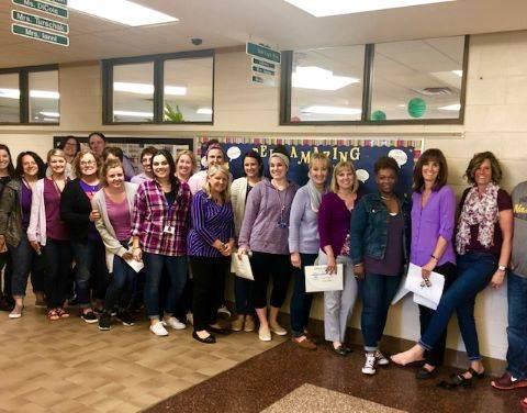 staff dressed in purple