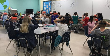students using virtual reality viewers in a classroom