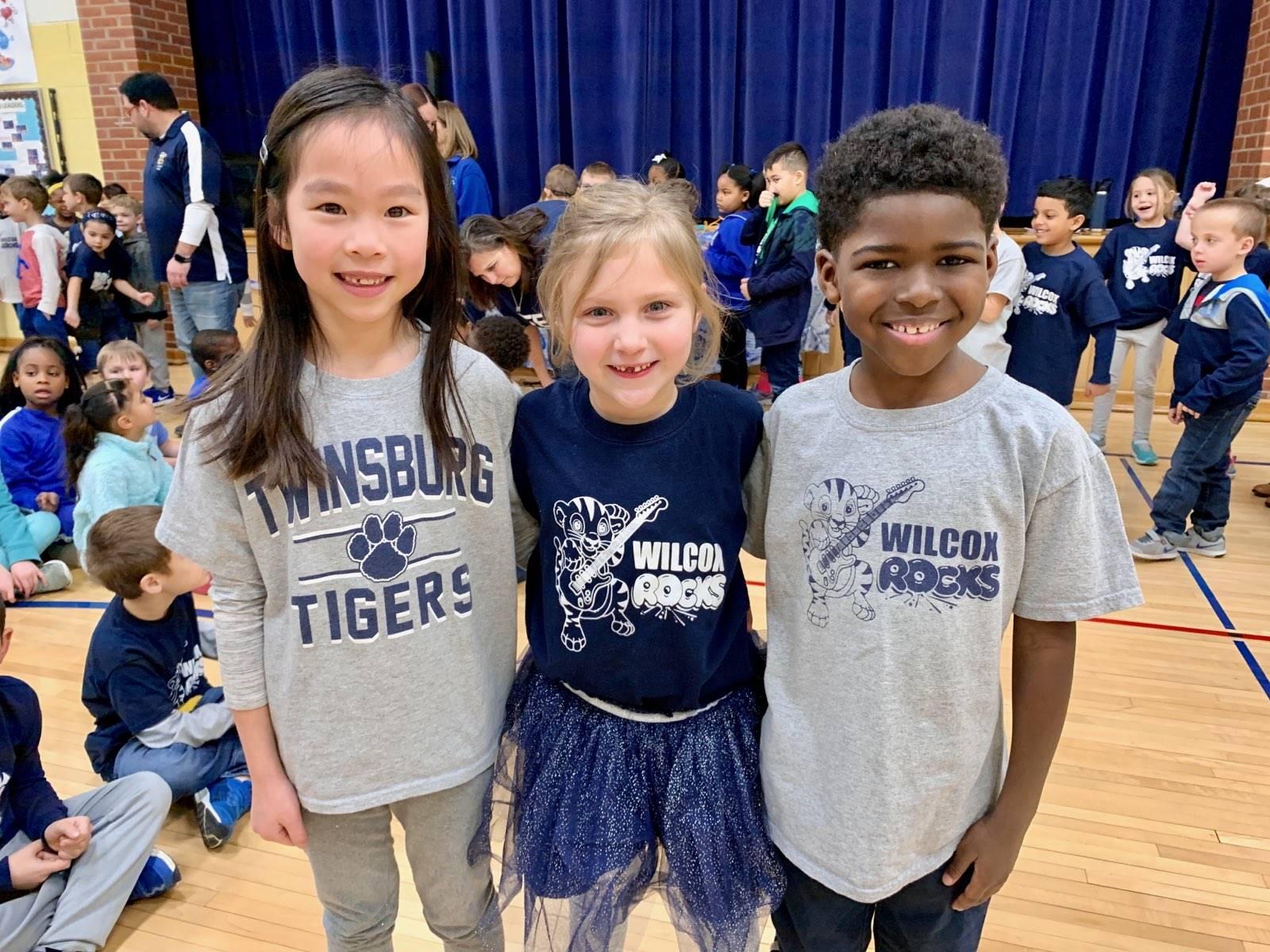 three students wearing Twinsburg Tiger Spiritwear