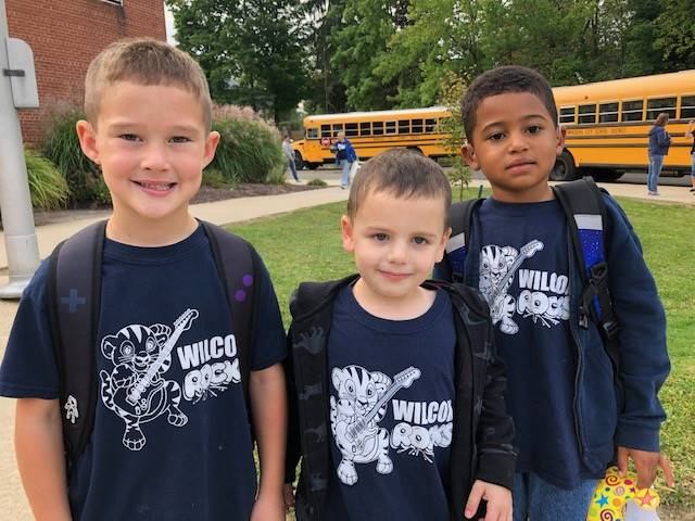 three students wearing spirit wear