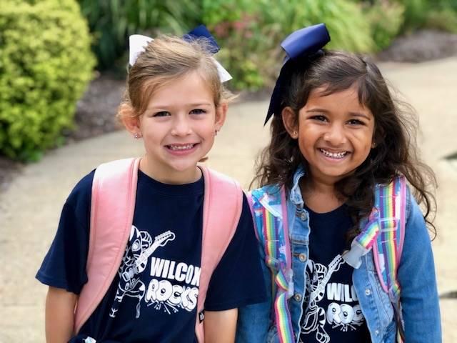 two students wearing spiritwear