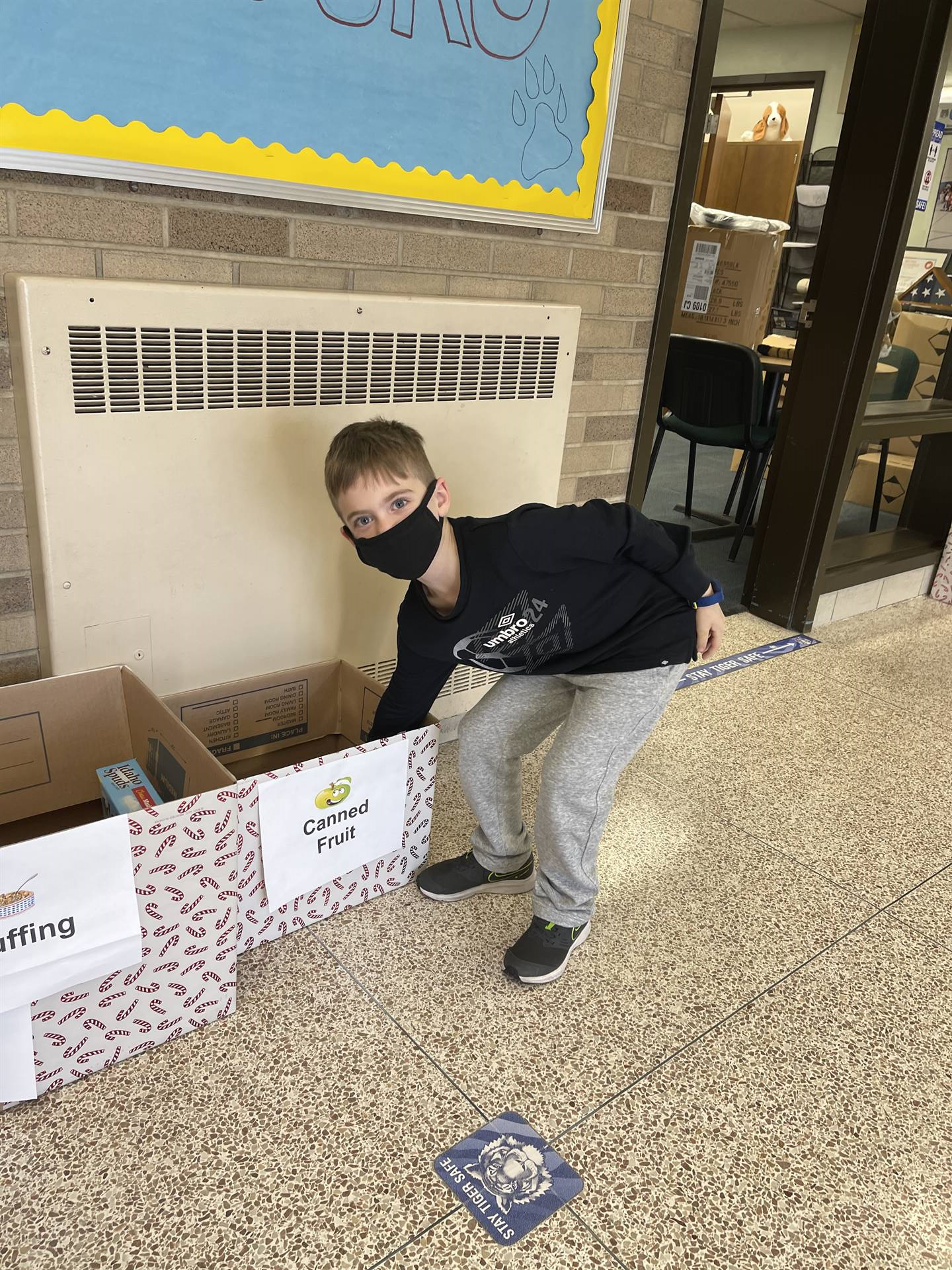 student standing by donation box
