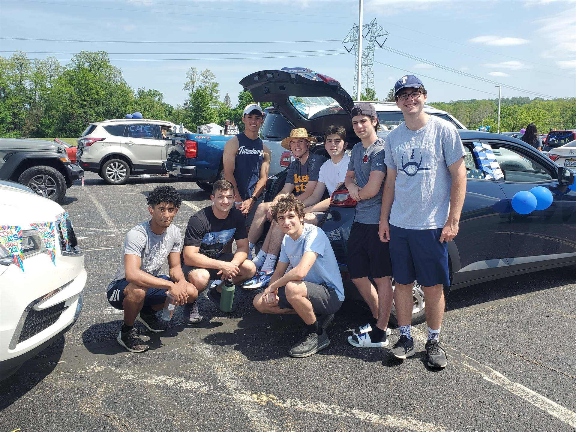 students outside of car