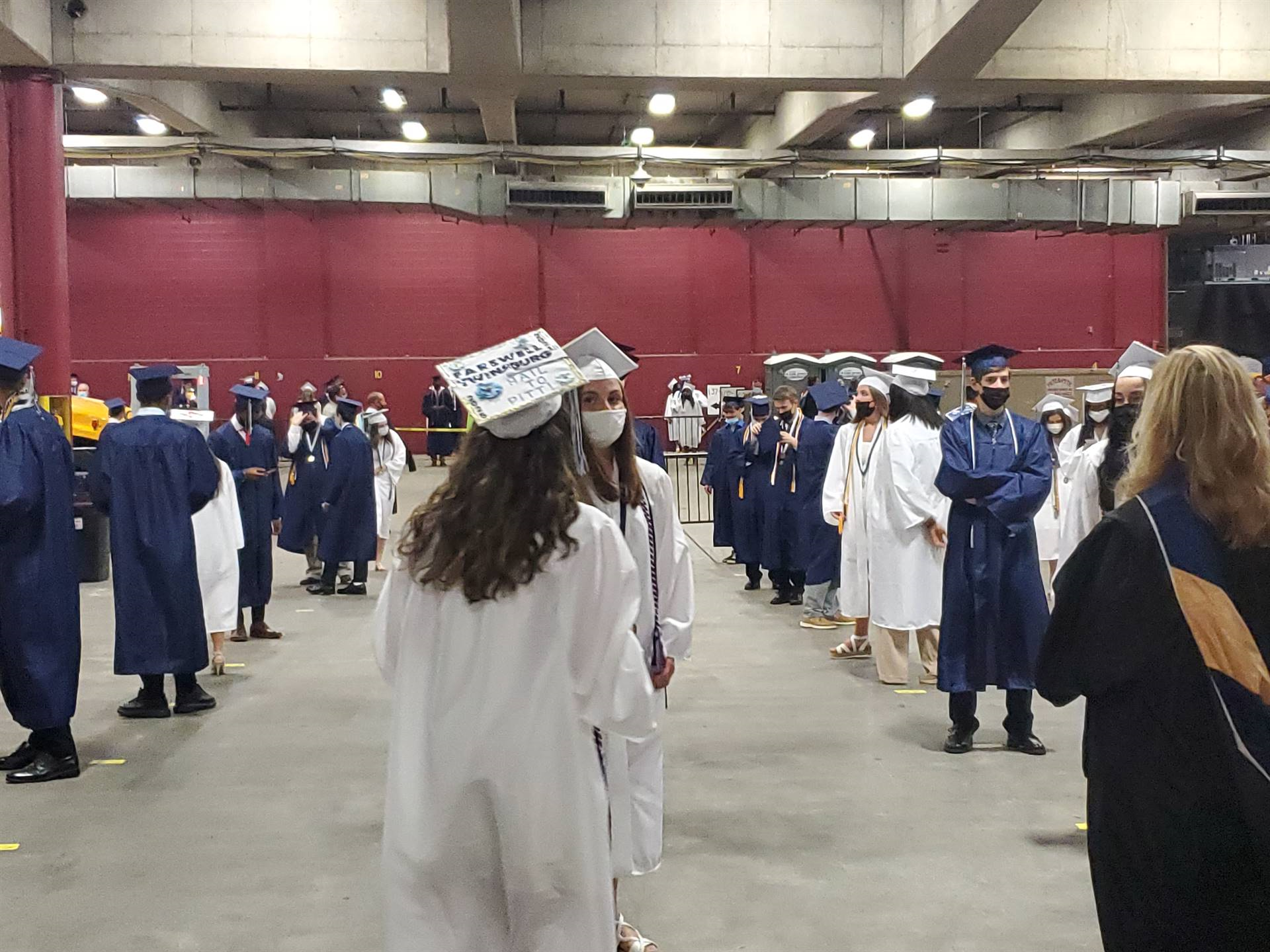 students waiting to begin commencement