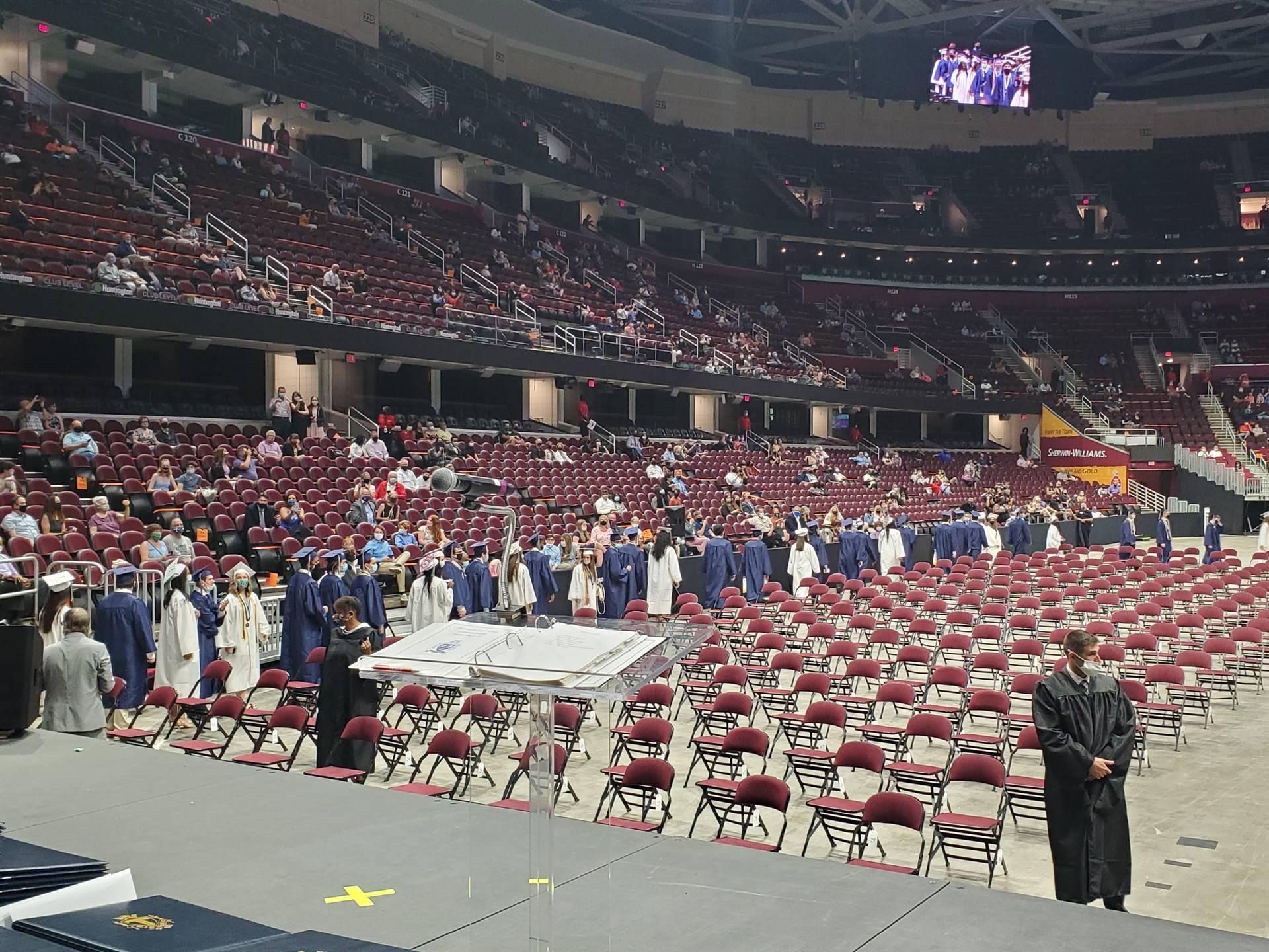 graduates entering the arena