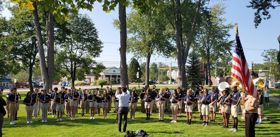 marching band performing in park