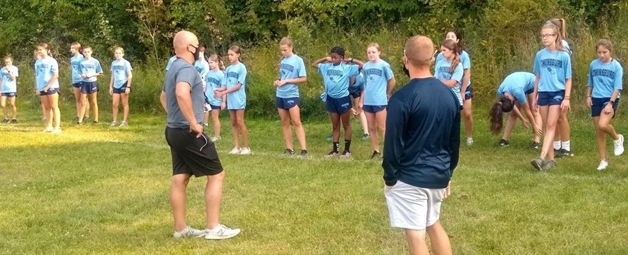 cross country students and coaches