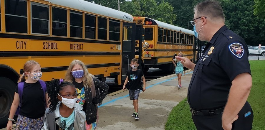 police chief welcoming students arriving to school