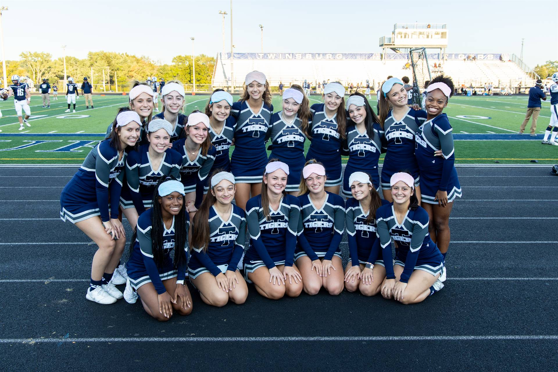 The Cheerleaders posing for a picture together.