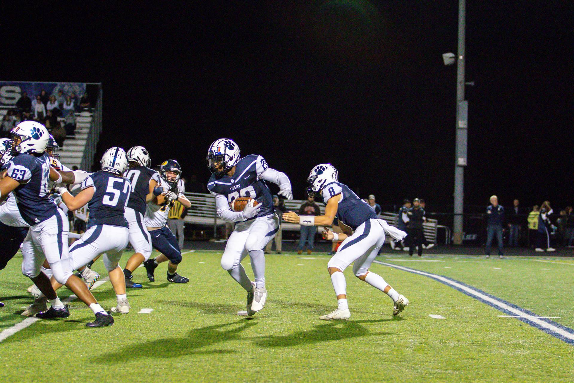 The running back taking the handoff from the quarterback.